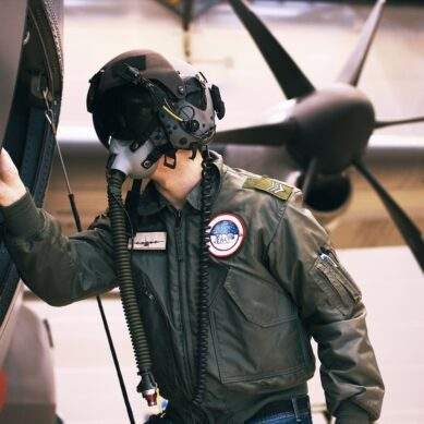 Shot of a fighter pilot inspecting his aircraft