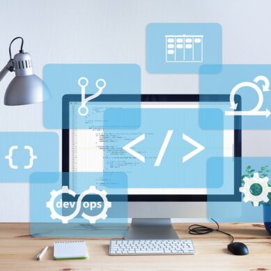 Software development workplace in bright office with wooden table, programming coding code on desktop computer screen, IT information technology developing and coding